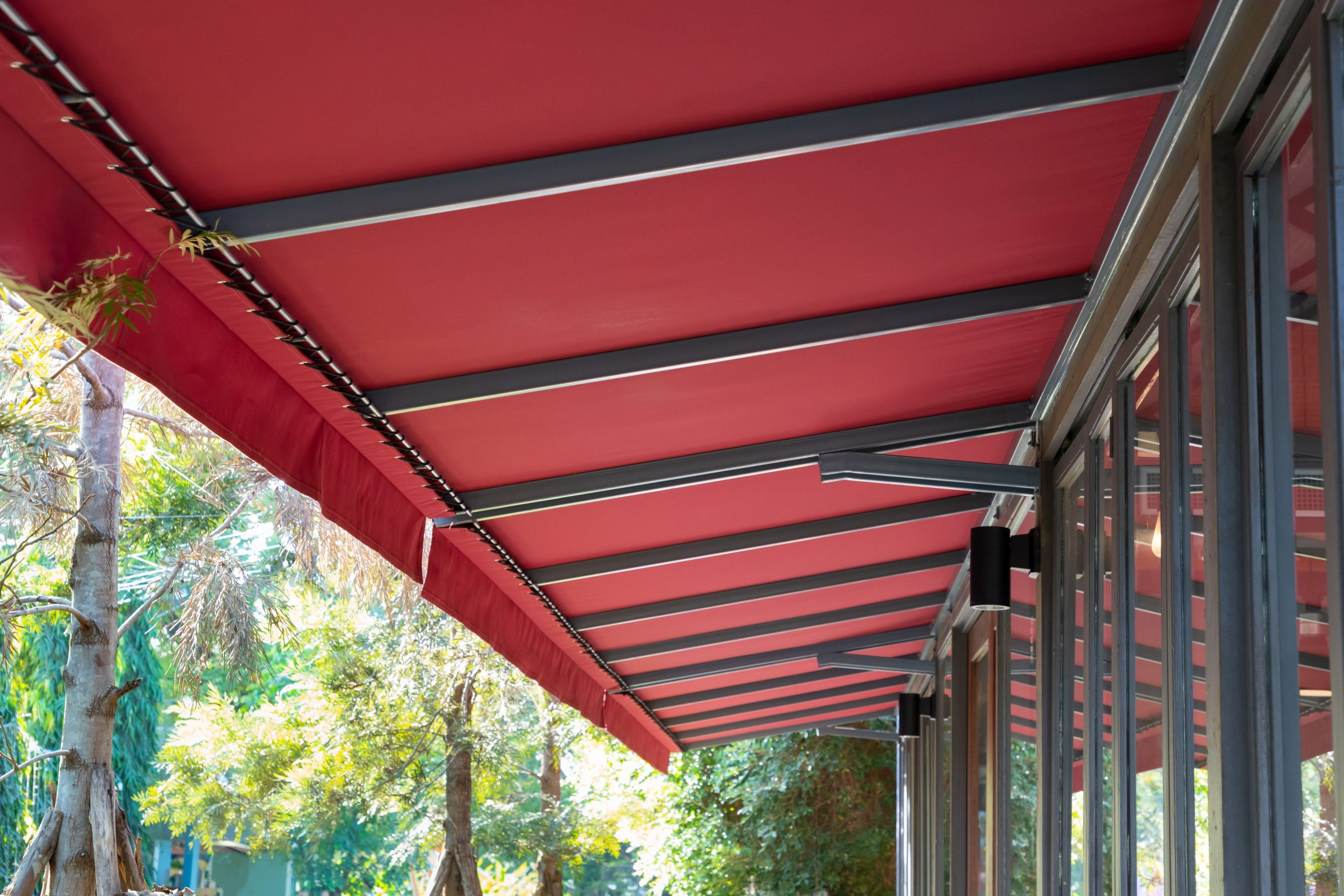 red fabric awning with steel structure roof